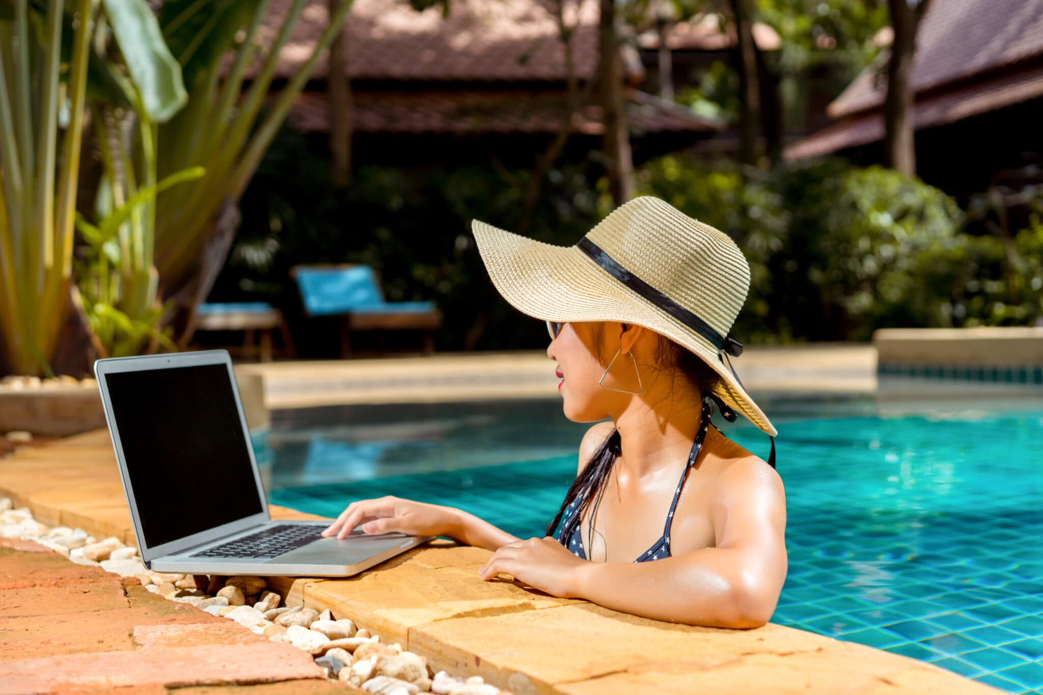 woman working remotely as Florida resident in pool